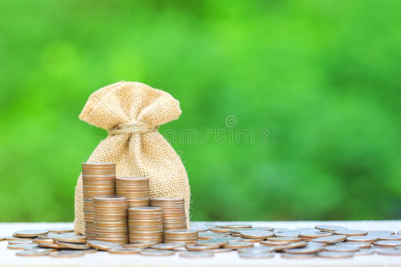 Stack of coins money and bag natural green background, Business investment growth and Save money for prepare in future concept.  stock photos