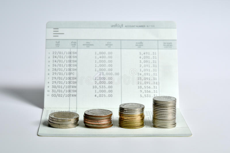 Stack of coins step up on bank saving account book. Financial and money savings management concept royalty free stock photo
