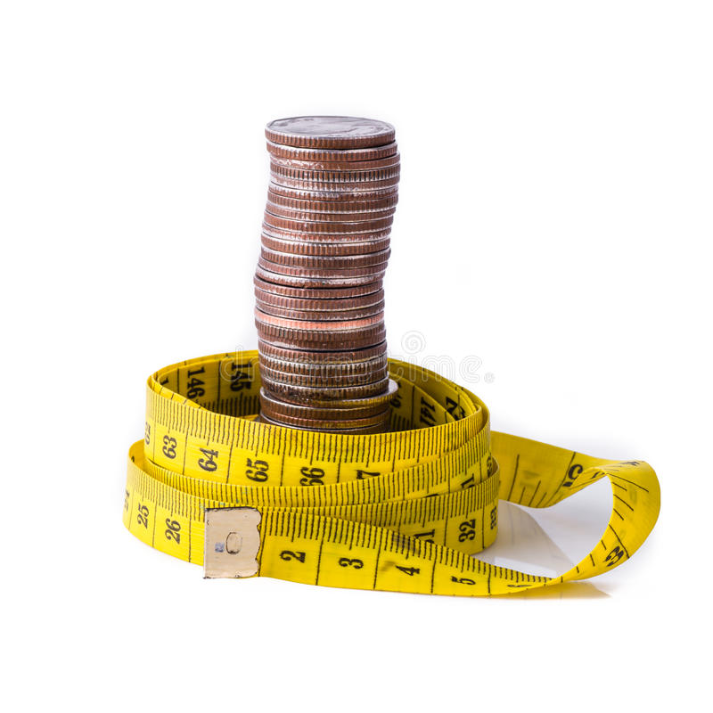 Stack of coins with tape measuring isolated royalty free stock image