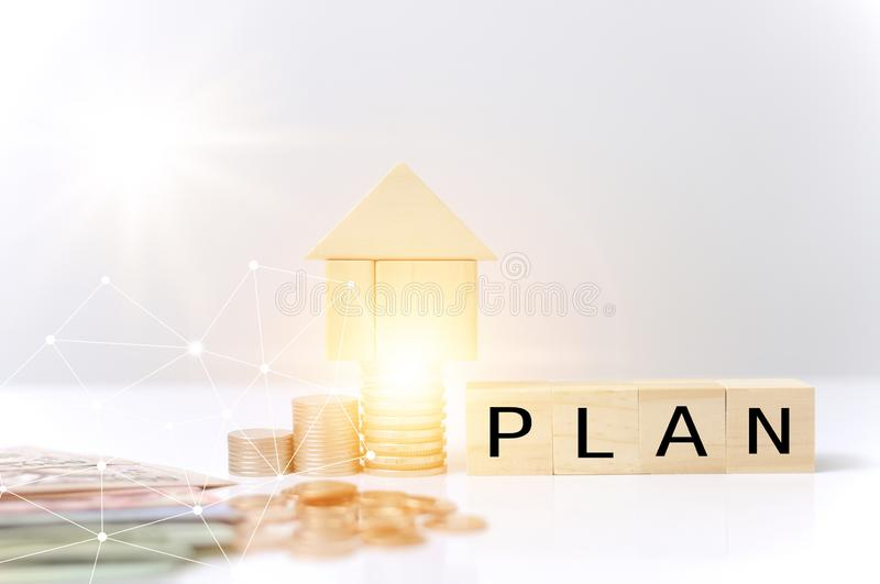 Stack coins,wooden blocks house plan word with light effect graphic for internet of thing link communication technology saving to. Stack coins,wooden blocks stock photography