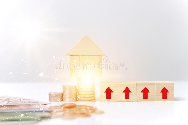 Stack coins,wooden blocks house red arrow grow light effect graphic for internet of thing link communication technology saving to. Buy or loan a home business stock image