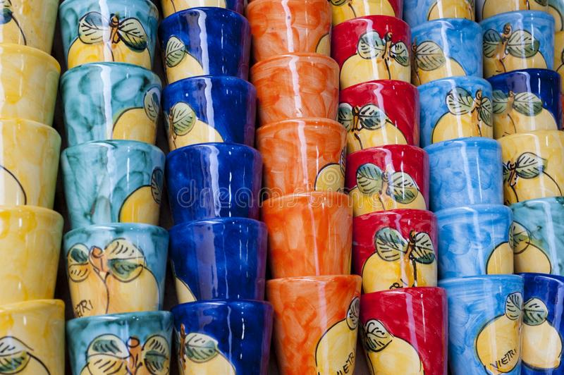 Stack of colored cups stock photos