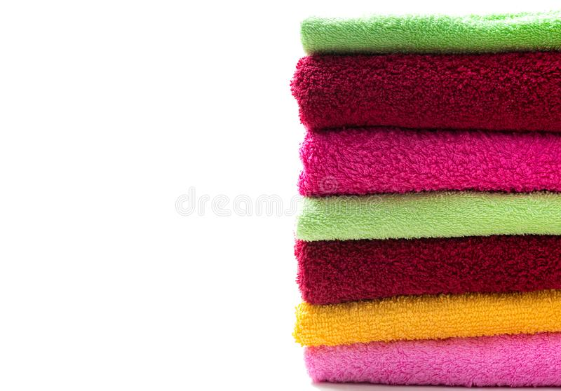 Stack of colorful bathroom towels. Stack of colorful bathroom towels, hygiene, bath isolated on white background royalty free stock image
