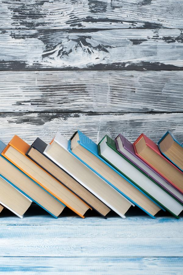 Stack of colorful books. Education background. Back to school. Book, hardback colorful books on wooden table. Education stock photos