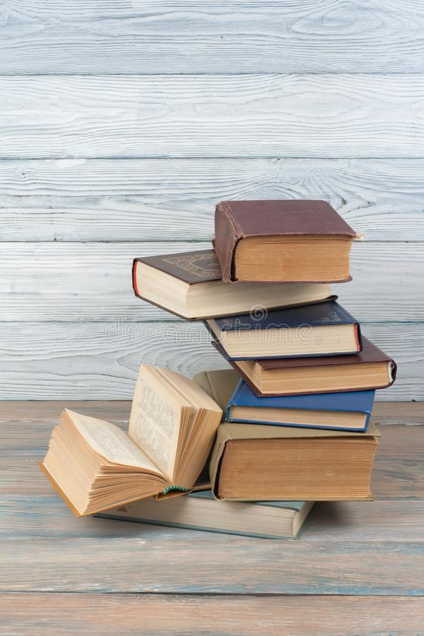 Stack of colorful books. Education background. Back to school. Book, hardback colorful books on wooden table. Education royalty free stock photography