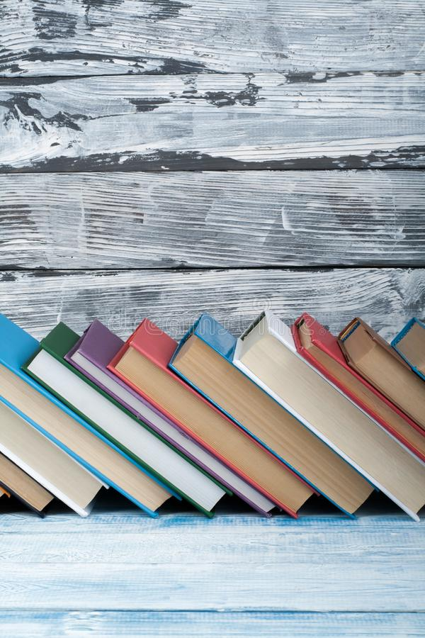 Stack of colorful books. Education background. Back to school. Book, hardback colorful books on wooden table. Education royalty free stock photo
