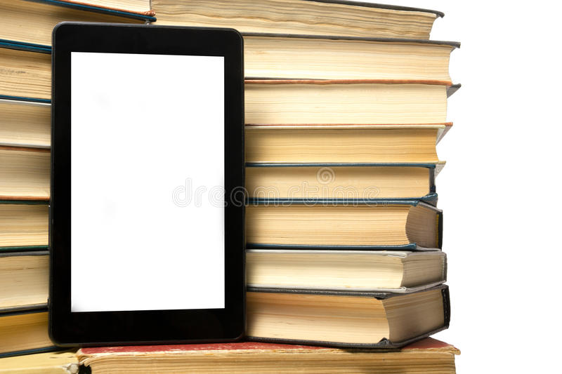 Stack of colorful books and electronic book reader. Electronic library concept. Back to school. Copy space stock images