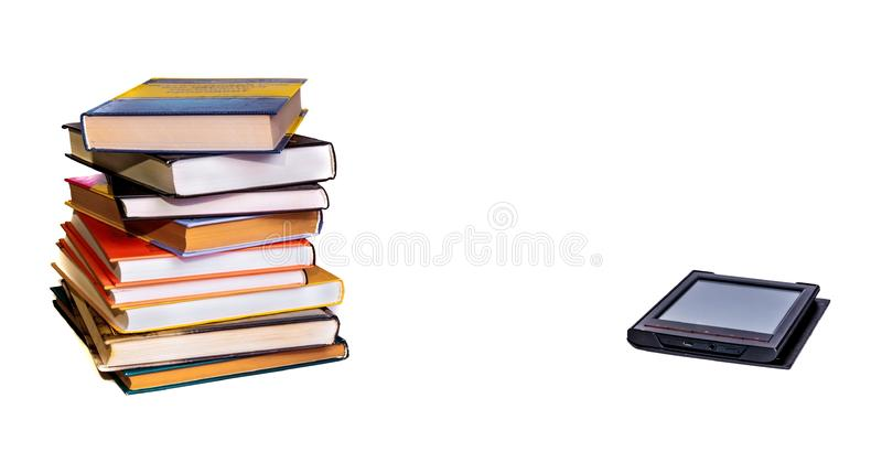 Stack of colorful books with electronic book reader. Isolated on white stock photography