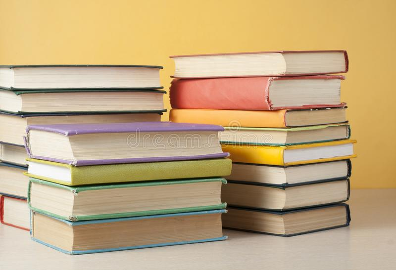 Stack of colorful books on the wooden table. Education background. Back to school. royalty free stock photo