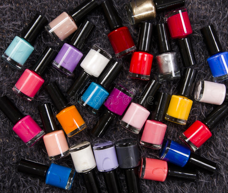 Stack Of Colorful Bottles Of Nail Polish. Stock Image - Image of ...