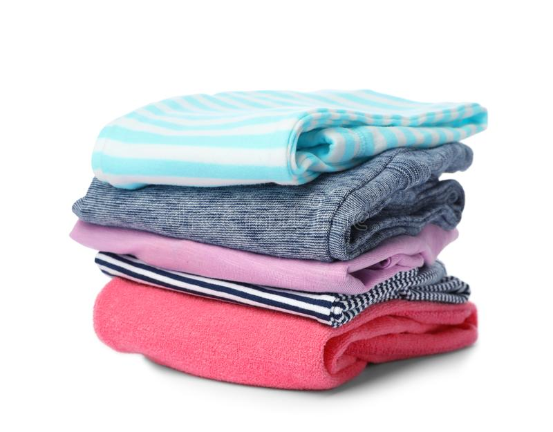 Stack of colorful children`s clothes royalty free stock images