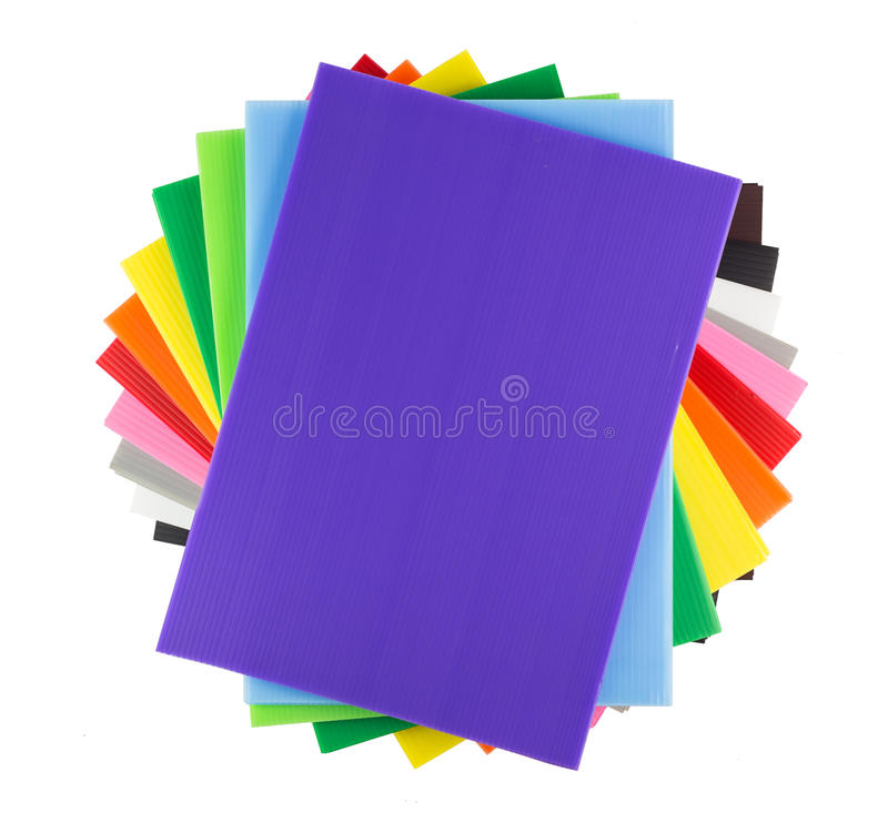 Stack of colorful corrugated plastic sheets stock photo