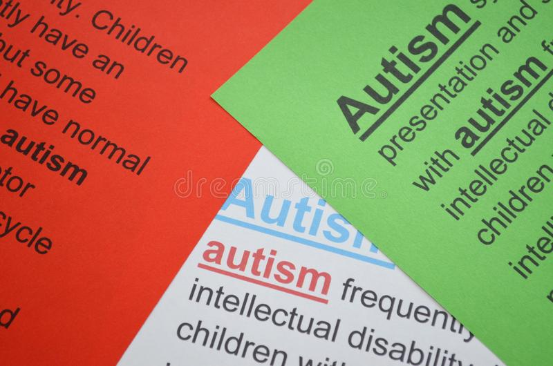Word AUTISM , close up. Stack of the colorful paper with word -text autism stock image
