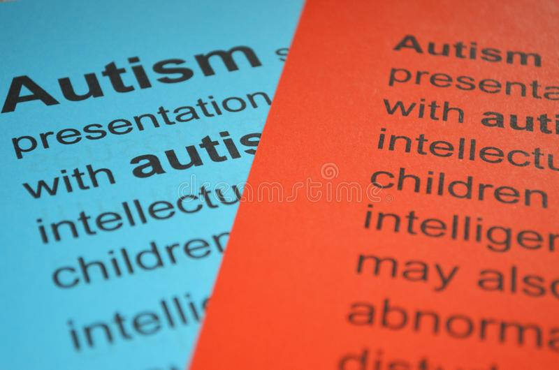 Word AUTISM , close up. Stack of the colorful paper with word -text autism royalty free stock photo