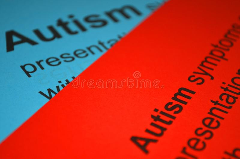 Word AUTISM , close up. Stack of the colorful paper with word -text autism royalty free stock photography
