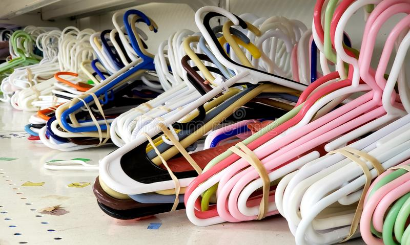 A stack of colorful plastic clothes hangers on a shop shelf royalty free stock photography