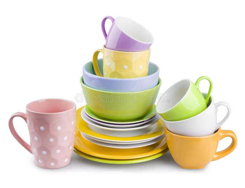 Stack of colorful plates and cups isolated on white background stock photo