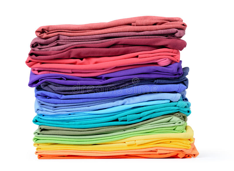 Stack of colorful t-shirt isolated on white background. File contains a path to isolation. royalty free stock photo