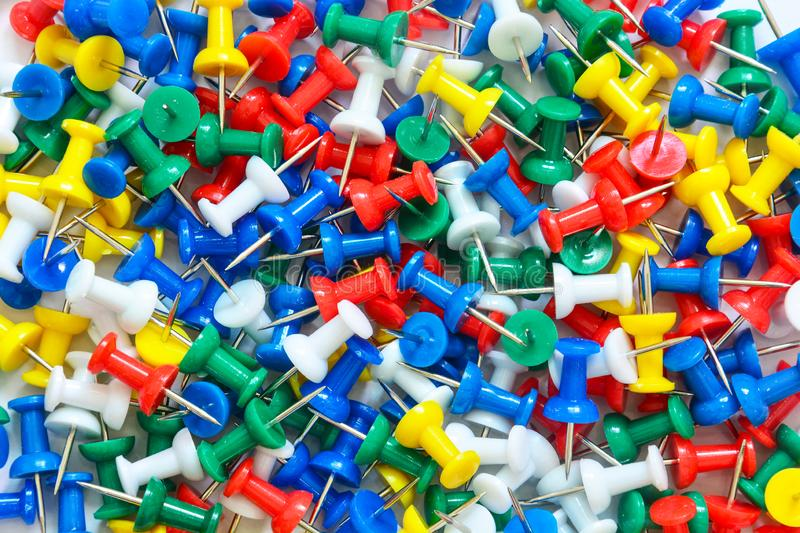 Stack of colorful thumbtack push pin on white background stock photos