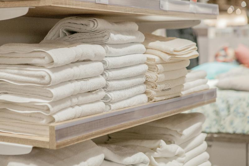 Stack of colorful towels in the department store. Many pile of cotton towels in store shop. Concept of shopping, buy and sell stock images