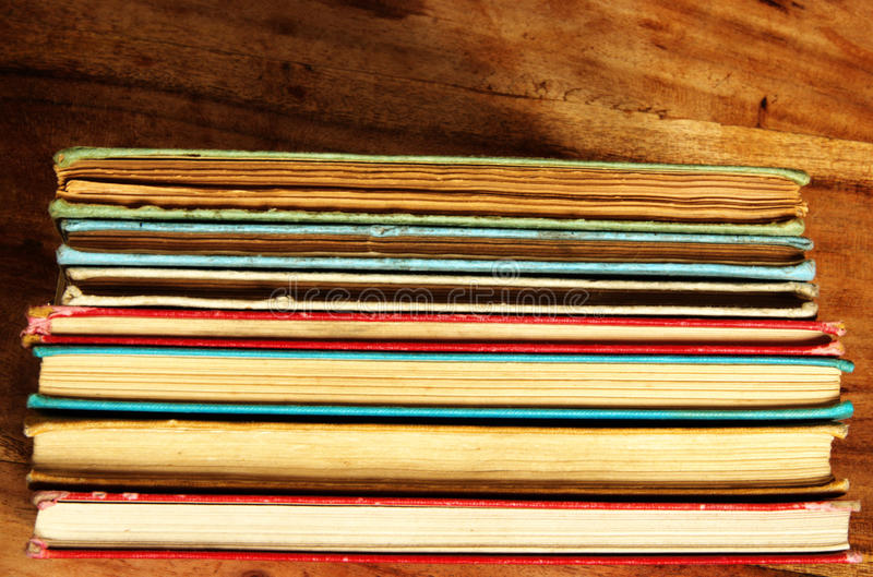 Stack of colorful vintage books stock photography