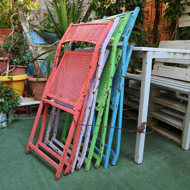 A stack of colourful metal chairs royalty free stock photo