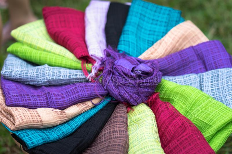 Stack of colourful silk scarfs royalty free stock photo