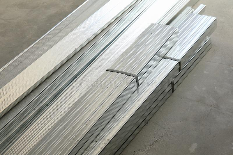 Stack of aluminum profiles on a concrete floor royalty free stock photos