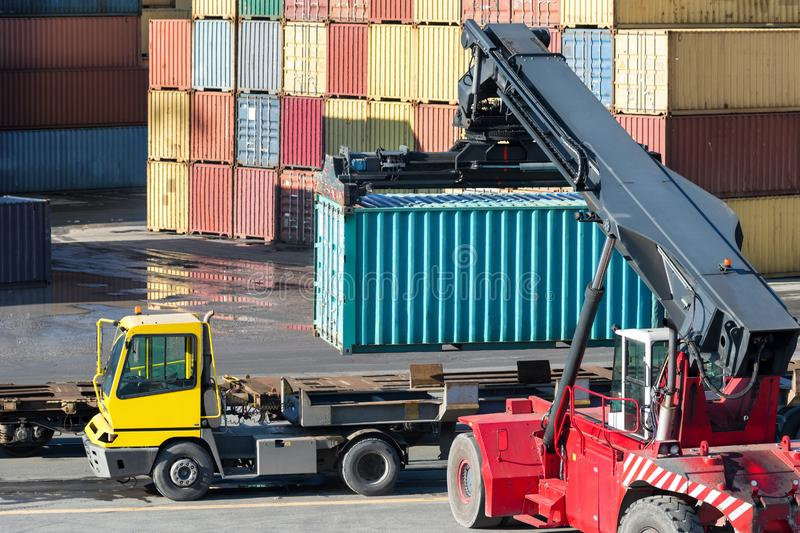 Stack of containers with truck and forklift royalty free stock images