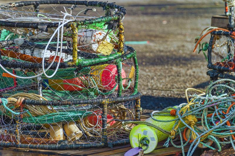 Close up of crab baskets, ropes and buoys stock photo