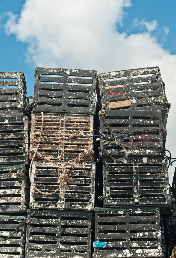 Stack of crab pots. Front view of stacks of plastic crab pots covered with barnacles, dry out under tropical tropical sun at the end of the harvesting season royalty free stock photography