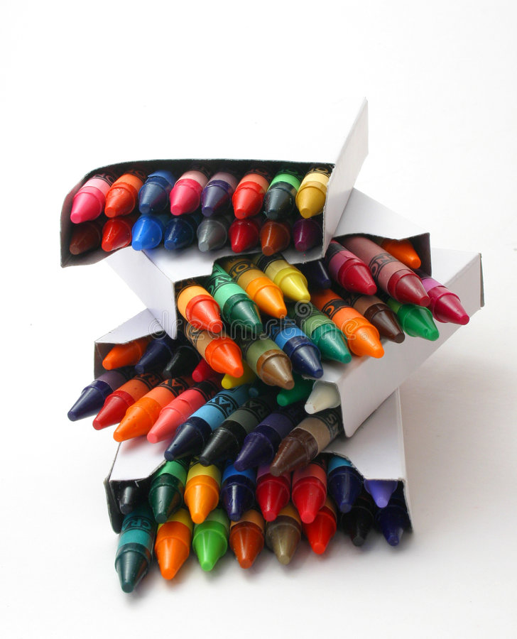 Stack Of Crayon Boxes Over White royalty free stock images