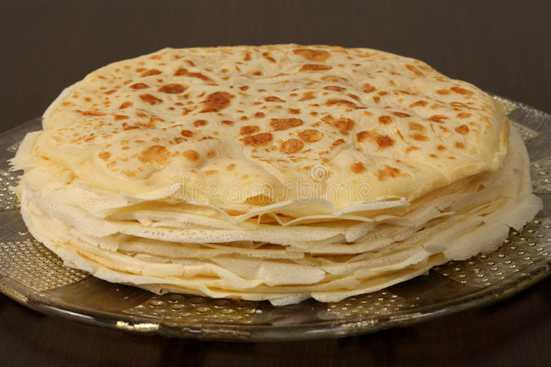 Stack of crepe. On a plate and black background stock image