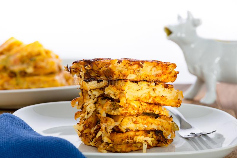 Stack of crispy waffle hash browns on a plate stock image