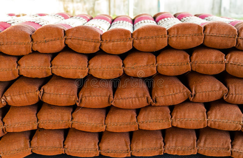 Stack of Cushions chair pillows pile. Vertical outdoor shot. Stack of Cushions chair pillows pile. Vertical outdoor shot on Natural light royalty free stock photo