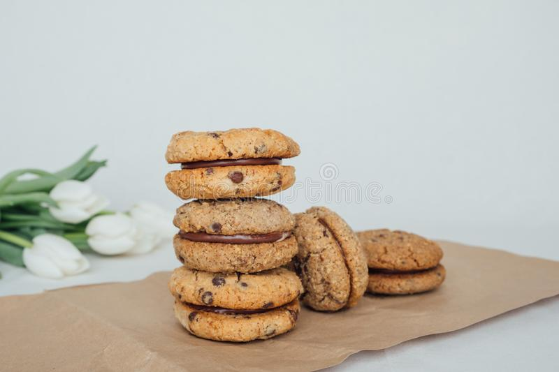 Delicious crumbly sandwich cookies Baci di Dama or Lady kisses with chocolate filling. Stack of delicious crumbly almond or hazelnut sandwich cookies Baci di stock photos