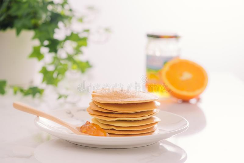 Stack of delicious pancakes on plate isolated on white stock photography