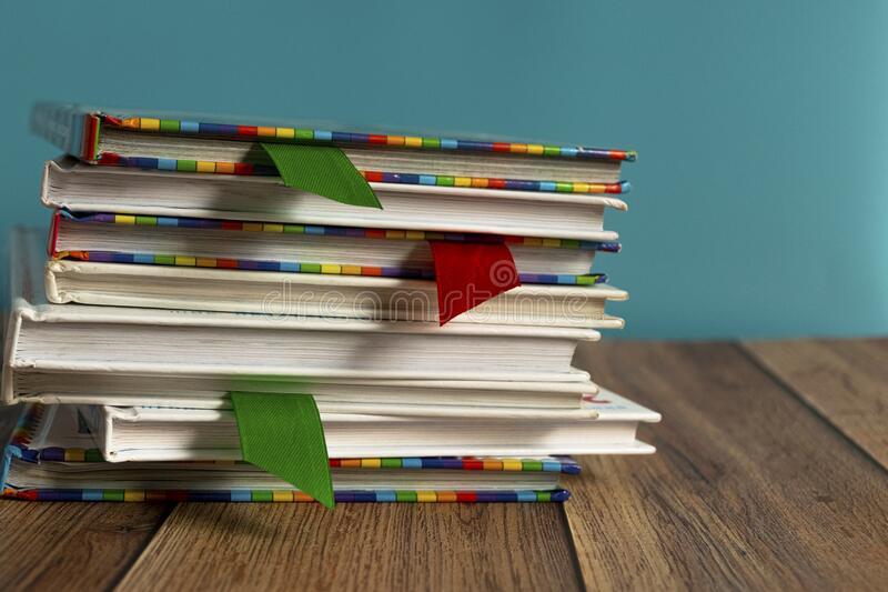 A stack of different bookmarks with bookmarks for pages. Book binding. Knowledge and education. Books for children. School library royalty free stock photos