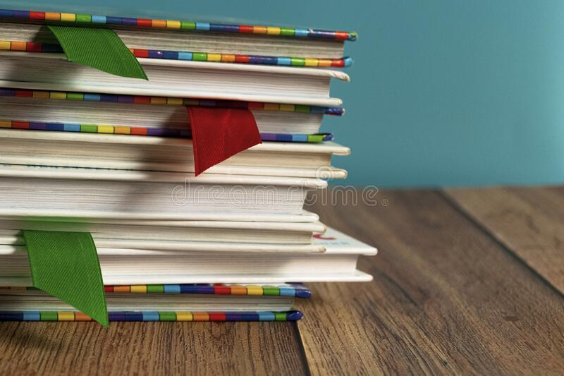 A stack of different bookmarks with bookmarks for pages. Book binding. Knowledge and education. Books for children. School library royalty free stock images