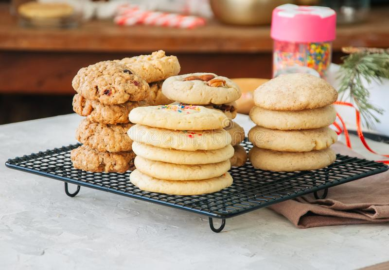 Stack of different festive cookies on a wire rack. Preparation t stock image