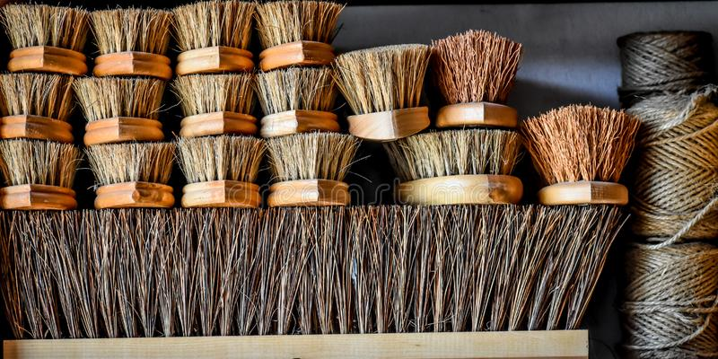 Stack of Wooden Bristle Brushes and Twine royalty free stock photos