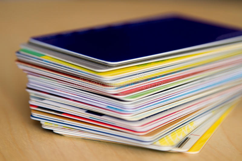 A stack of discount cards. A stack of colorful discount cards on the table royalty free stock photography