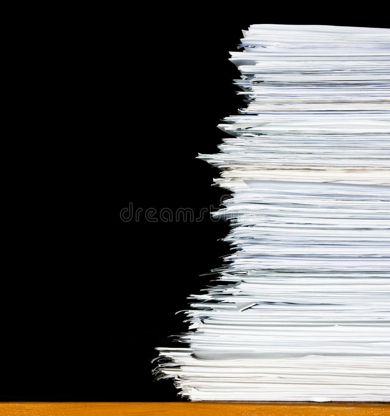 Stack of documents or files, overload of paperwork. On black background royalty free stock photo