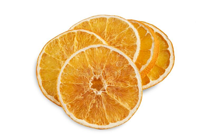 Stack of dried orange slices isolated on white royalty free stock photos