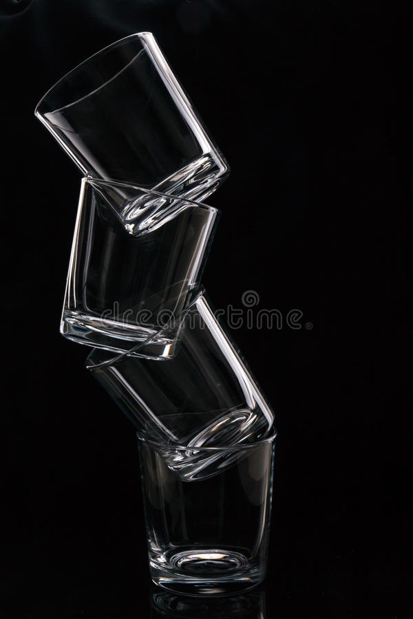 Stack of drinking glasses stock images