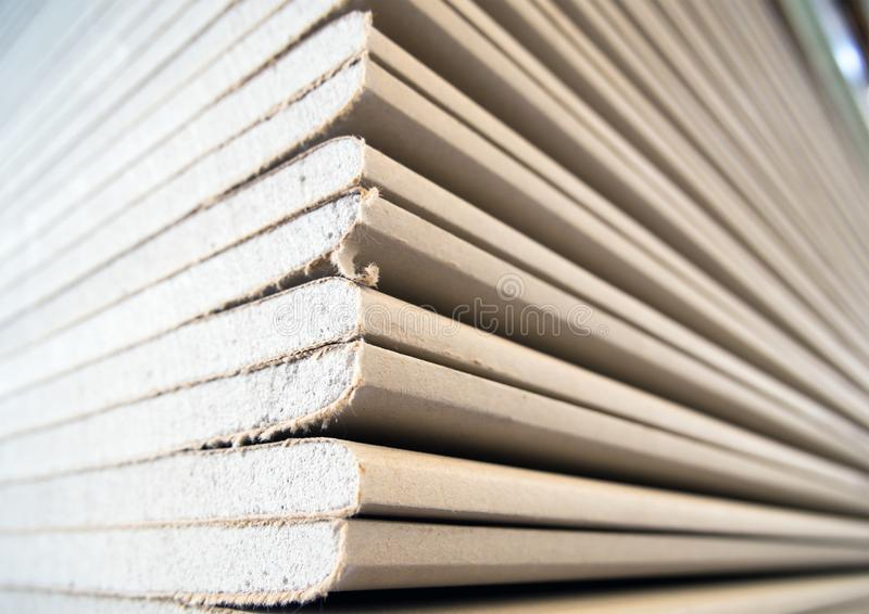 A stack of drywall sheets in stock.  stock photography