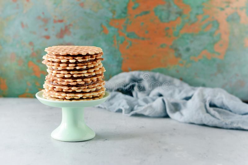 A stack of Dutch waffles with salted caramel on a gray background. Sweet waffle royalty free stock images