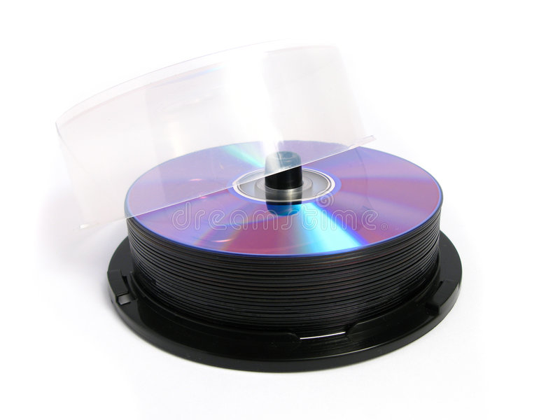 Stack of DVDs and CDs. In a package, on a white background royalty free stock image