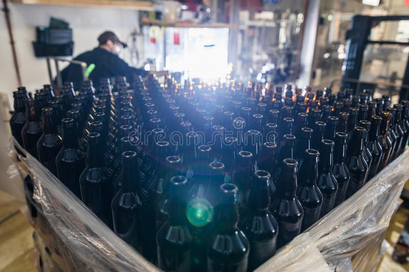 Stack of empty beer bottles stock images