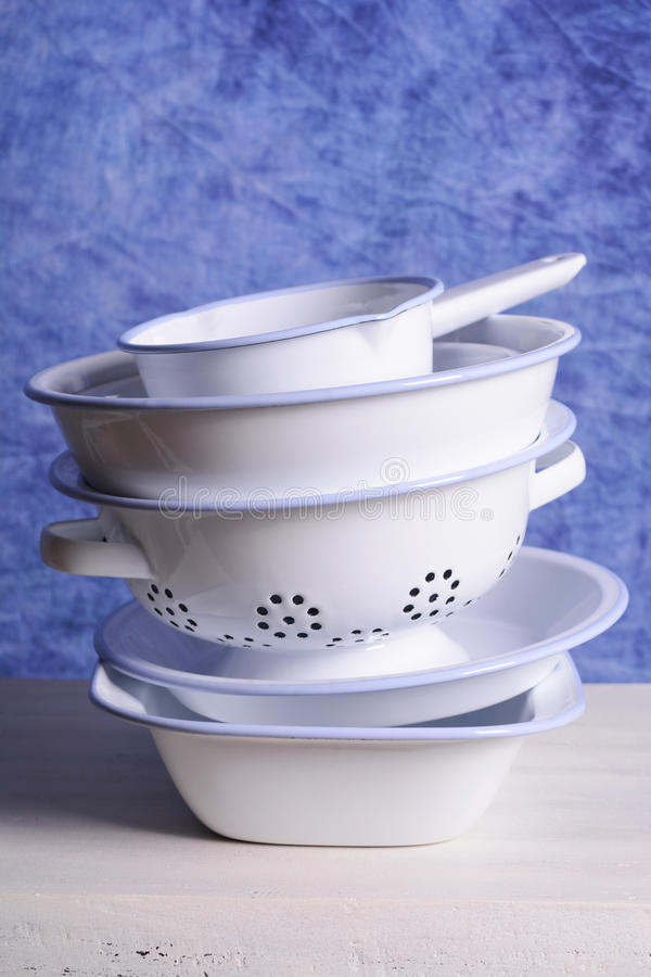 Stack of enamel kitchen bowls and pans. royalty free stock image